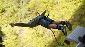 man bungee jumping in the Scottish highlands