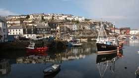 boats on the water at charlestown harbour in cornwall