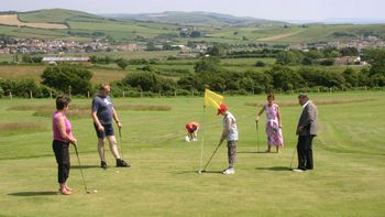 group of golfers on the highlands end pitch and putt course
