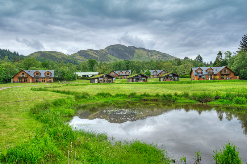 Loch Lomond lodges with mountains behind
