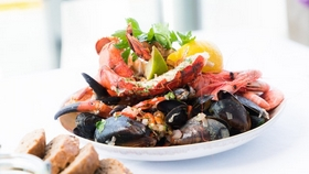 delicious seafood meal with prawns, mussels and lemon
