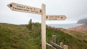 signpost next to eype beach on the south west coastal path