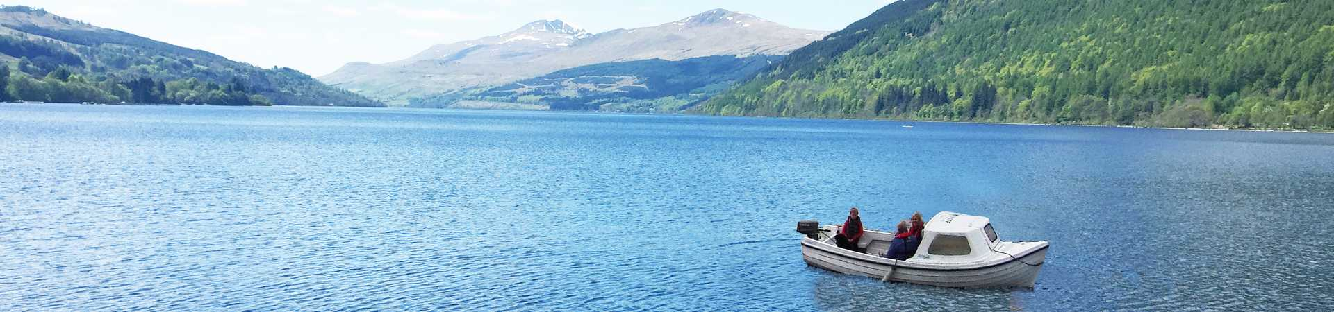 people on a boat excursion on loch tay with incredible views