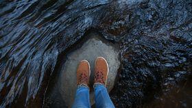 pair of feet in a cave terrain